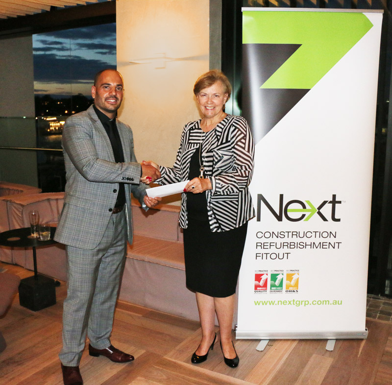 Joseph Di Girolamo presents Rosemary Smithson of the Property Industry Foundation with a cheque for $10,000 to mark the 10 year anniversary of Next.